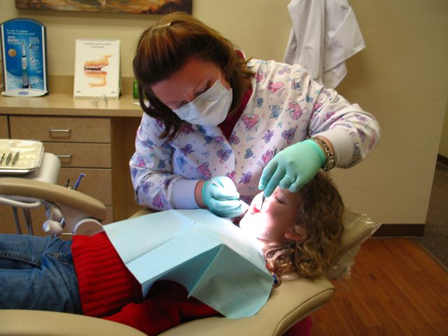Molly getting her teeth cleaned and poked